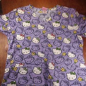 Sanrio hello kitty purple scrub top medium.